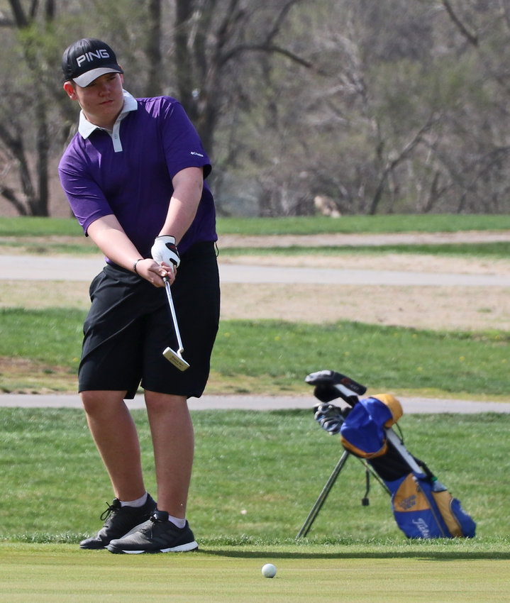 Blair's Tyler Lantry takes a long putt on No. 9 Tuesday at River Wilds Golf Club.