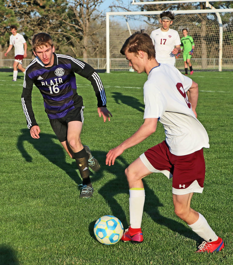 Blair's Tyler Schroder, left, defends against Waverly's Jaxon Jensen on Tuesday at Krantz Field.