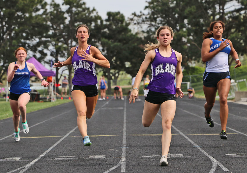Blair sprinters Grace Galbraith, middle left, and Reese Beemer, middle right, finish out front during their preliminary race Friday at Krantz Field.