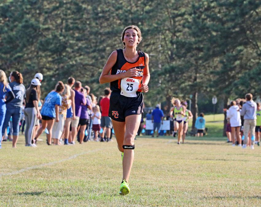Fort Calhoun freshman Bria Bench races down the final stretch Tuesday in Plattsmouth.