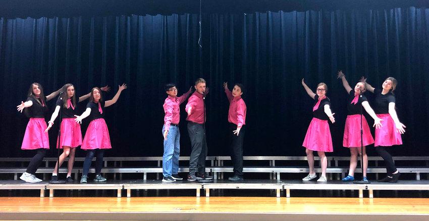 Stella Lewis (left), Kailynn Gubbels, Bailey Bracht, Dillon Kim, Jacob Hoefs, Will Eppenbaugh, Evelyn Hilton, Hailey Hill, and Kate Miller. Students rehearse a dance number for the Arlington High School variety show.