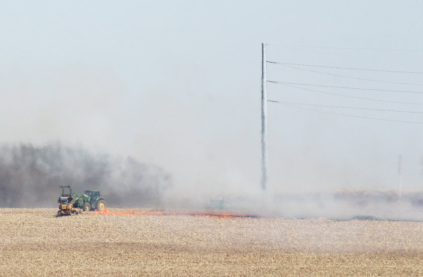 Farmers and firefighters battle a field fire south of U.S. Highway 30 between Arlington and Kennard on Saturday.