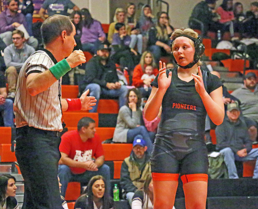 The Pioneers' Haley Albertson calls to stand up with her opponent Friday at Fort Calhoun High School.