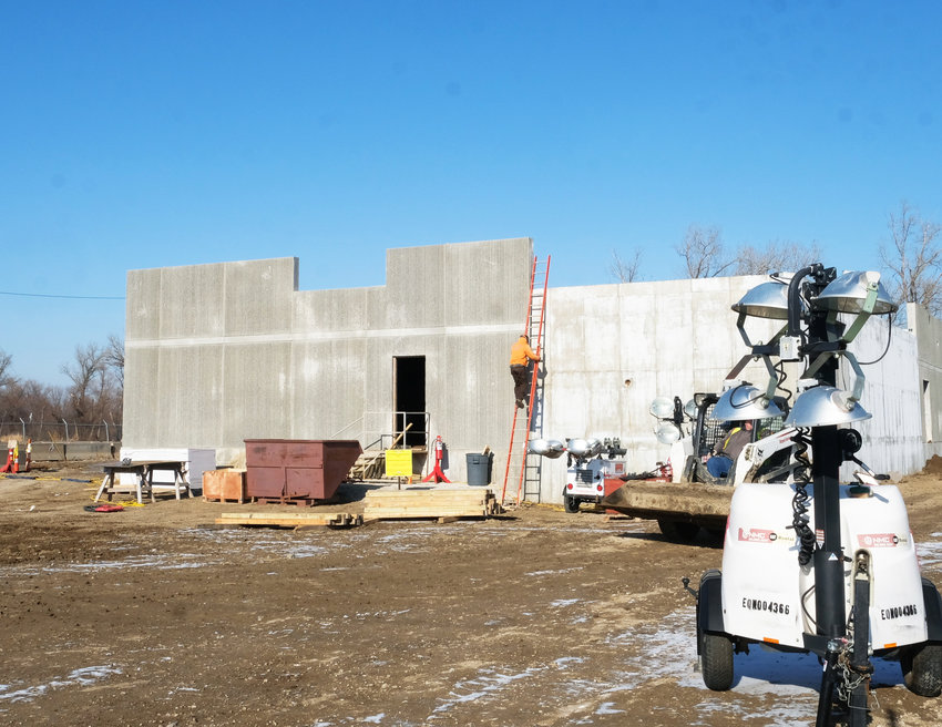 A security building being constructed near the steel and concrete spent nuclear fuel storage facility will be staffed indefintely following the decommissioning of the site.