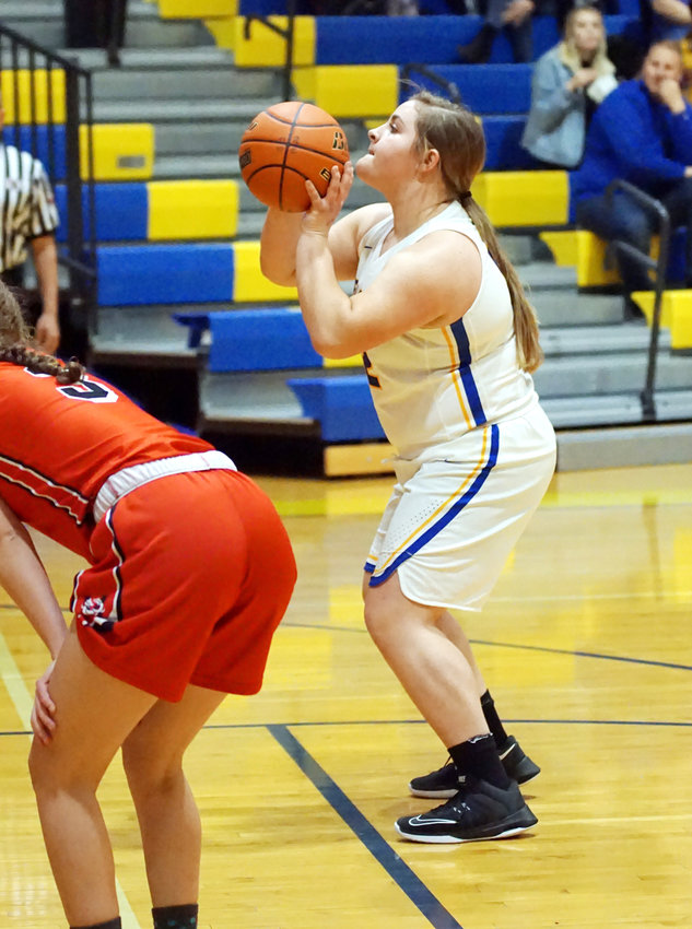 Cailey Stout #52 eyes the hoop and makes good on the free throw in the win over Madison last week. Stout scored 5 points and gathered in 2 rebounds in the win over the Dragons.