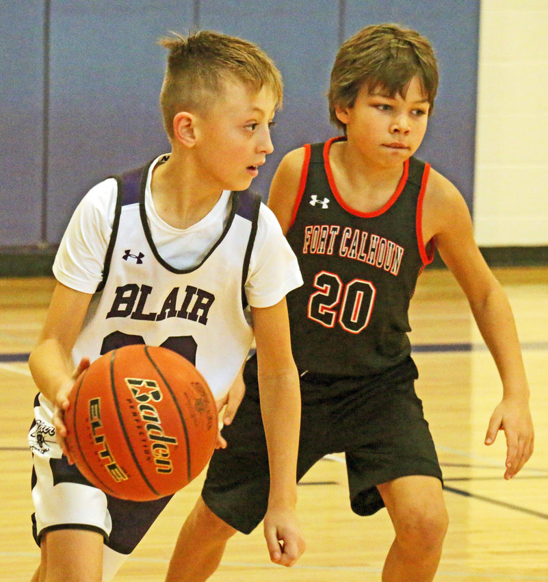 Blair Basketball Club fourth-grader Rylan Olsen, left, is guarded by Fort Calhoun's Quentin Billesbach on Saturday during the Hoopstock Classic at Otte Blair Middle School. For the second straight week, the Blair Basketball Club hosted a home tournament over the weekend with this particular bracket ending with the fourth-grade Purple team as champions.
