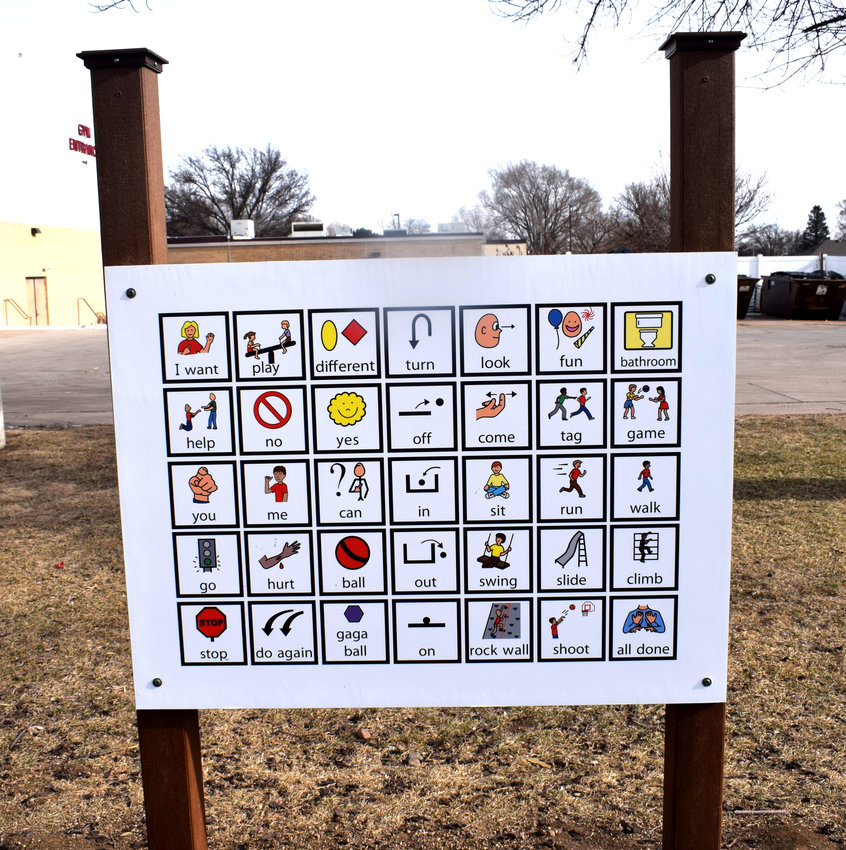 A sign was installed near the playground at Arlington Elementary School to help non-verbal students communicate what they want to do.