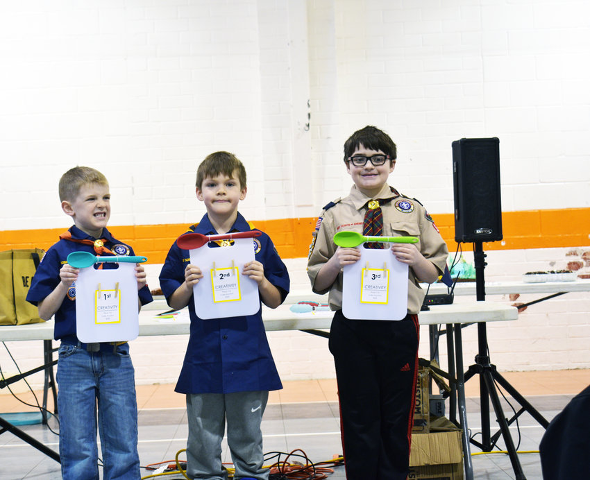 From left: Fort Calhoun Cub Scout Pack 114 members Sam Richardson, Isaac Andersen and Aiden Tinkham placed first, second and third, respectively, in the creativity category at the pack's annual cake auction on Jan. 19. Money raised from the auction goes toward activities for the Cub Scouts pack.