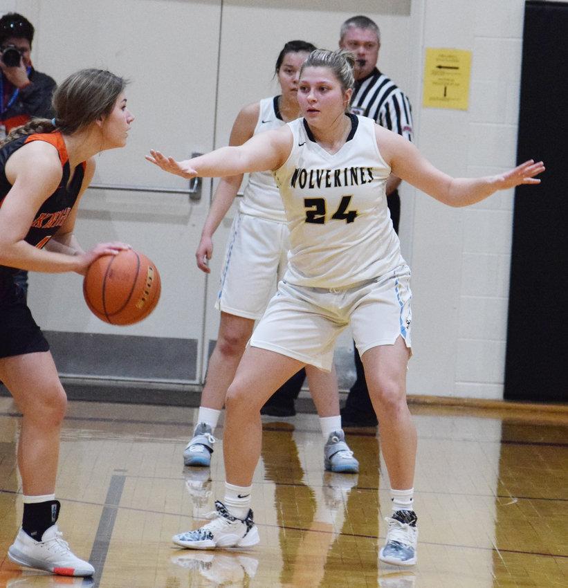 Alyssa Buchholz paying defense on the O-C ball handler.