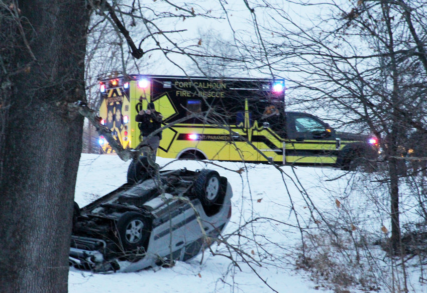 Deputy Shawn Thallas takes photos of an overturned Jeep after an accident Tuesday in West Market Square Park in Fort Calhoun. Fort Calhoun Rescue responded to the crash. The driver as uninjured.