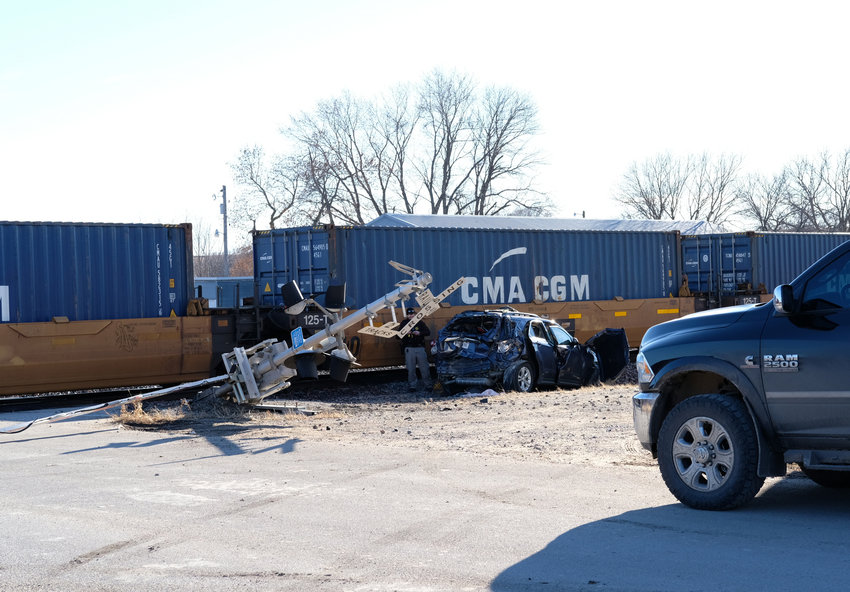 A vehicle hit by a Union Pacific train sits along the tracks in Kennard on Saturday afternoon.