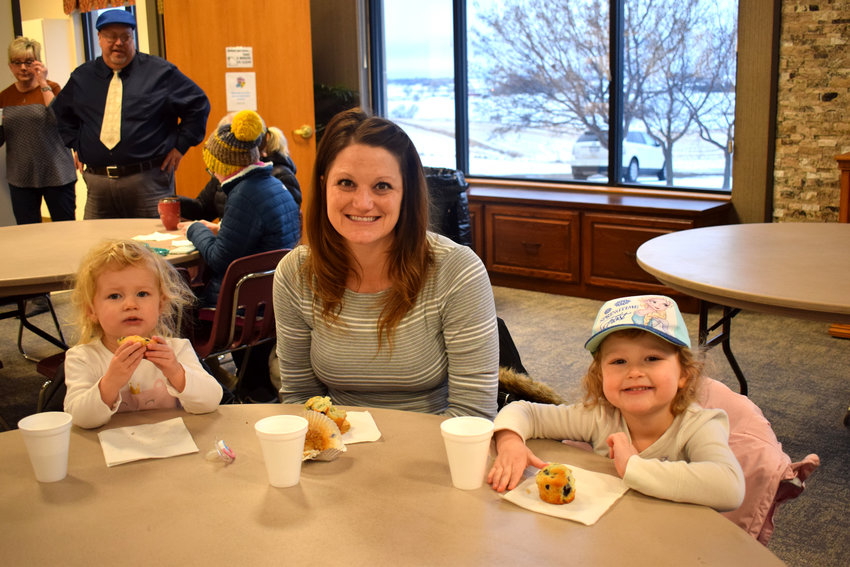 Sarah Dunklau enjoys muffins with Ella (right) and Leah at the Muffins with Moms event at St. Paul's School Tuesday.