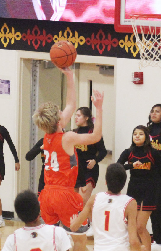 Coulter Thiele drives in to the basket for a layup Friday in Macy.