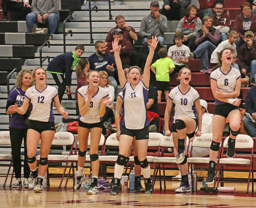 The Blair volleyball bench celebrates the Bears' five-set victory against South Sioux City on Tuesday during the Class B Subdistrict 5 Tournament at Columbus High School.
