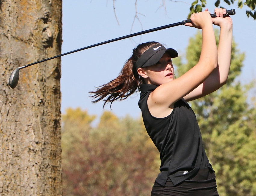 Arlington's Dianna Taylor tees off Tuesday during the Class C District 2 Tournament at Oakland Golf Club.