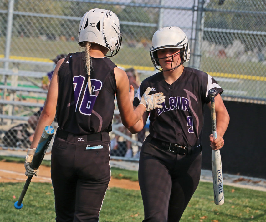 Blair seniors Julia Saylor, left, and Carmen Warrick meet on the field Friday at the Youth Sports Complex.