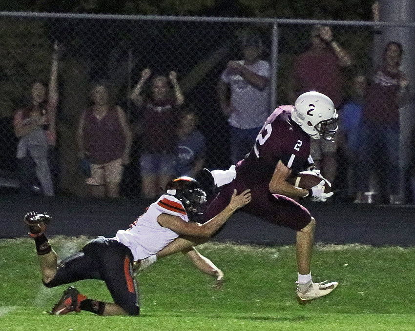 The Eagles' Dustin Kirk, right, escapes the grasp of Fort Calhoun's Avery Quinlan on Friday at Arlington High School.