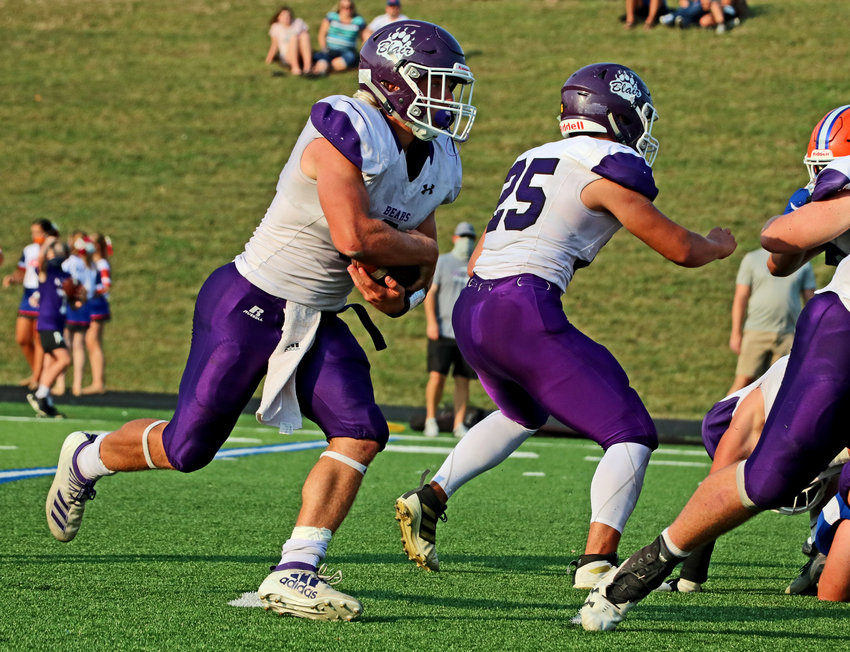 Blair senior Dex Larsen carries the ball Friday at Omaha Gross. The back finished with a school-record six touchdowns during the Bears' 54-14 win.