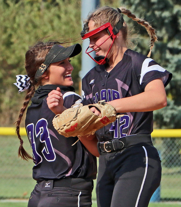 Bears senior Hallie Lewis and freshman pitcher Kalli Ulven celebrate a strikeout Friday during the Class B-5 District Finals at the Blair Youth Sports Complex.