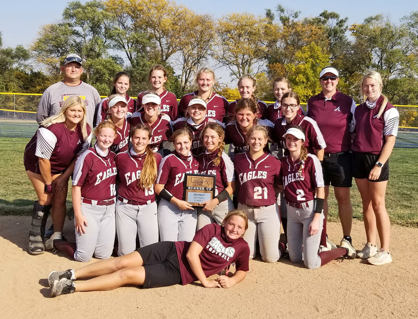 The Arlington softball team poses with its district runner-up trophy Oct. 9 in Malcolm.
