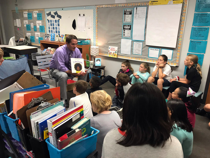 Liam Dawson, principal at Northside Elementary in St. James, Minnesota, and Blair native, reads to a fourth grade classroom last year. Dawson has been principal at the school since 2019. The school was recently named a National Blue Ribbon School by the Department of Education.