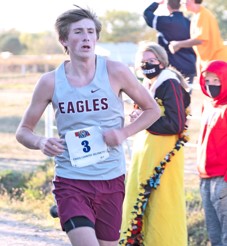 Arlington runner Colby Grefe competes Thursday during the district meet at Sycamore Farms near Waterloo.