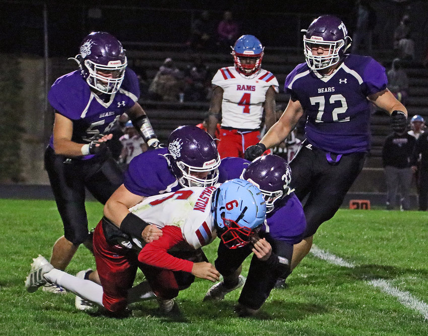 Blair tacklers Wesley Gunderson, middle left, and Kaden Sears combine to take down Ralston's Harrison Acklie as Braden Hanson, back left, and Nolan Ulrich, right, swoop in Friday at Krantz Field.