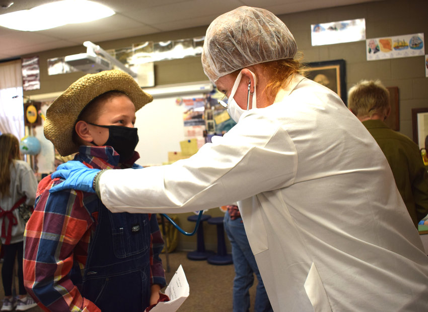 Owen Ladehoff gets his health check during the Ellis Island presentation on Monday.