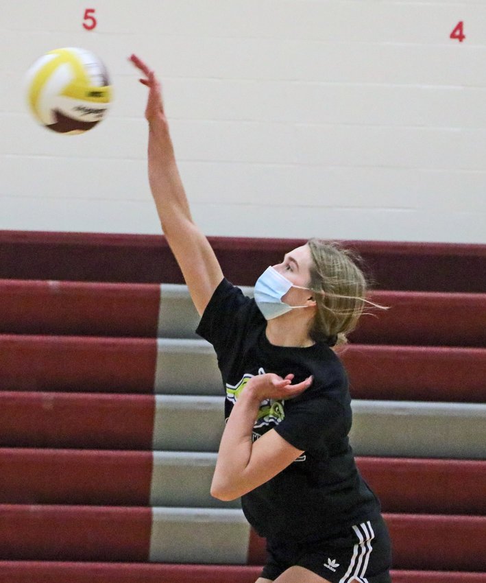 Eagles junior Chase Andersen spikes the ball Monday during practice at Arlington High School.