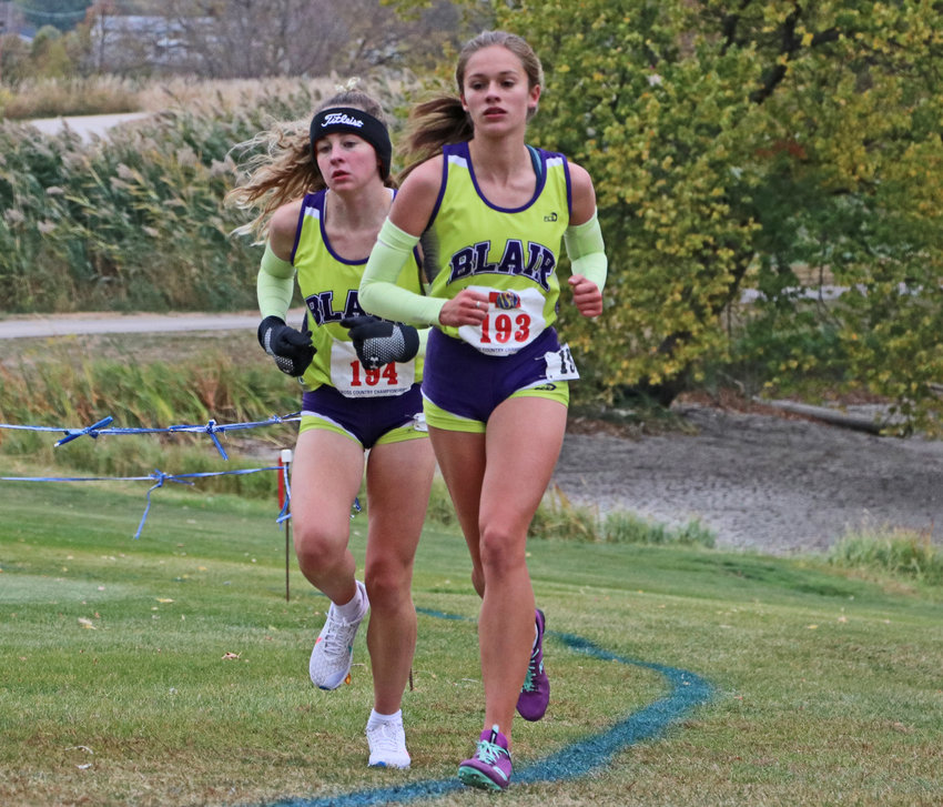 Blair's Allie Czapla, left, and Hailey Amandus run Friday during the NSAA State Cross Country Championships in Kearney. Amandus earned a state medal in 13th place.