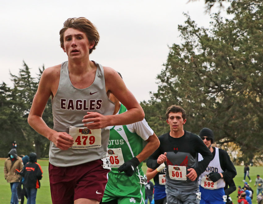 Arlington junior Colby Grefe, left, competes Friday during the NSAA State Cross Country Championships at Kearney Country Club.
