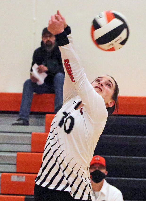 Pioneers libero McKenna Greenwell hits the ball up over her head and the net Thursday at Fort Calhoun High School.