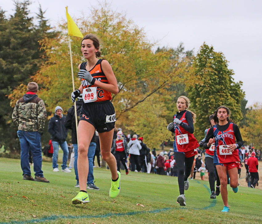 Fort Calhoun freshman Bria Bench, left, leads a pack of runners Friday during the NSAA State Cross Country Championships at Kearney Country Club.