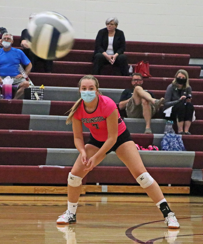 Arlington Eagle Claire Allen plays her spot on the floor during a match earlier on in her senior season. On Monday, the Eagles' senior class played its final match.