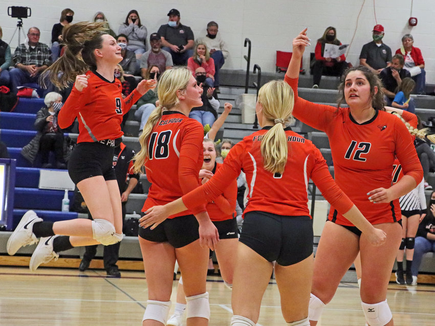 The Fort Calhoun volleyball team — Grace Genoways, from left, Ellie Lienemann, Kaitlin Smith and Alivia Cullen — react to the final point of their match win against Omaha Concordia on Monday at Wahoo High School.