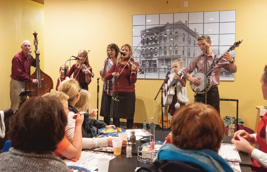 The Stangl Family Singers perform Christmas music last year during Christmas for the Coat at Fernando's Cafe and Cantina. The event, hosted by the Washington County Food Pantry and Joseph's Coat, was canceled due to the COVID-19 pandemic this year.