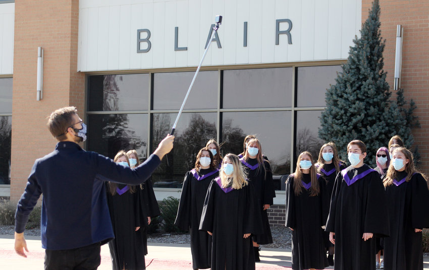 Director Kirk Schjodt records the Blair High School choir for a virtual concert, which will be released at a date to be determined, on Wednesday.