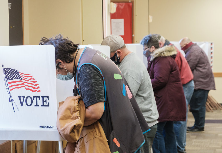 Voters fill out ballots at Arbor Park First Lutheran Church on Tuesday morning.
