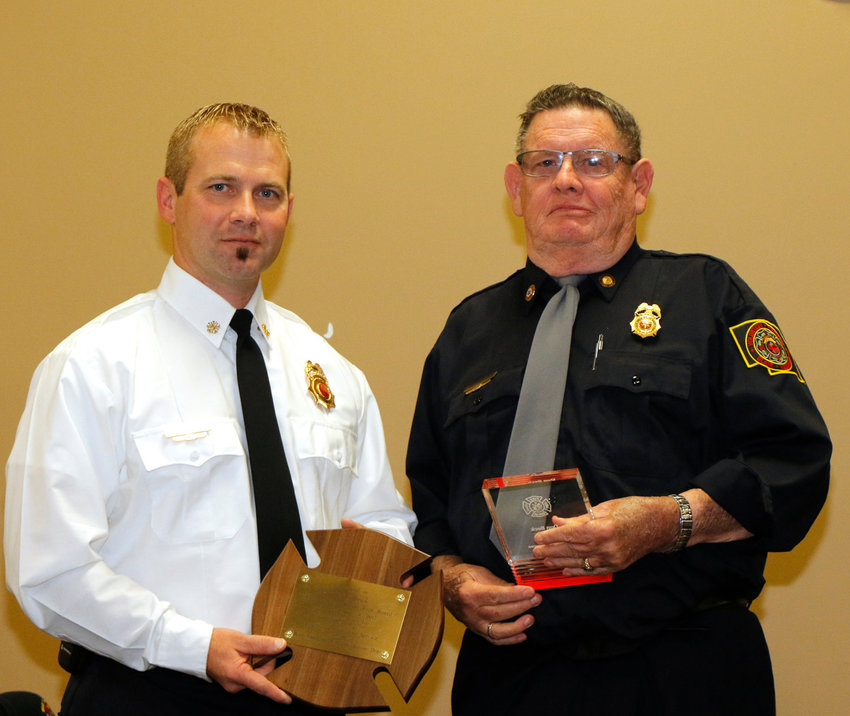 Blair Fire Chief Heath Reyzlik, left, presents Don Beck with his 40-year award at the Blair Volunteer Fire Department banquet three years ago.
