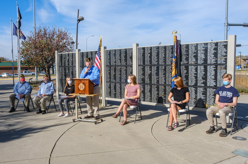Carl Lorenzen, chairman of the Washington County Veterans Tribute Plaza Memorial, leads a Veterans Day ceremony Wednesday as its recorded to be shown at schools and nursing homes on Veterans Day.