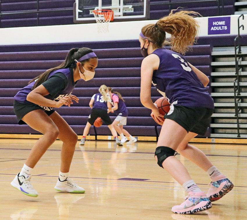 Basketball players Allison Hernandez, left, and Kaitlyn Johnson work Monday during a ballhandling drill at Blair High School.