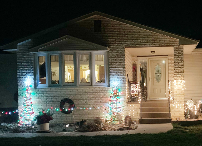 With lights all agolw, tis the season to let them shine.  Many, like Charlie and Debbie Krutilek took advantage of the beautiful late November weather to decorate for Christmas.
