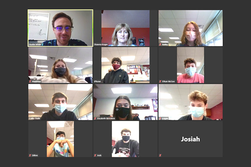 Students attend a Zoom lecture from the classroom, while Shawna Koger attends virtually after being quarantined.