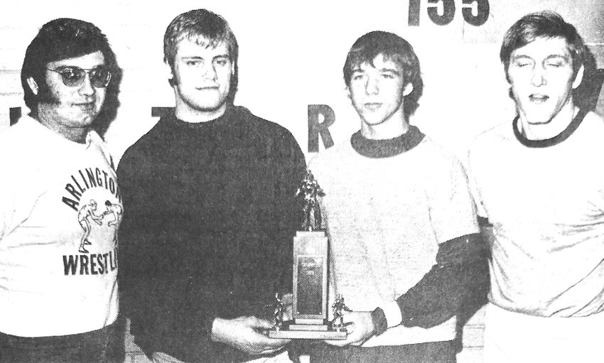 Arlington wrestling coach Dale Fernau, Rusty Fagerquist, Lonny Japp and coach Pinkerton pose for a photo with the Nebraska Capitol Conference Trophy in January 1975.