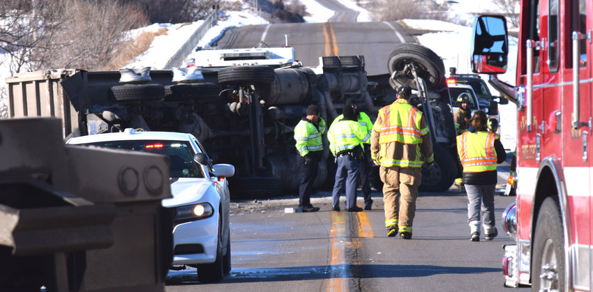 A semi-tractor trailer overturned on Highway 91 on Monday morning after trying to avoid a turning vehicle north of Arlington.
