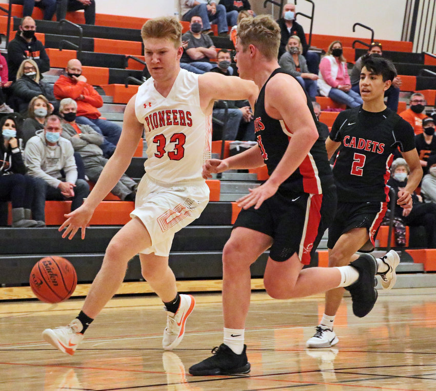 The Pioneers' Carsen Schwarz, left, tries to beat a pair of West Point-Beemer defenders to the bucket Saturday at Fort Calhoun High School.