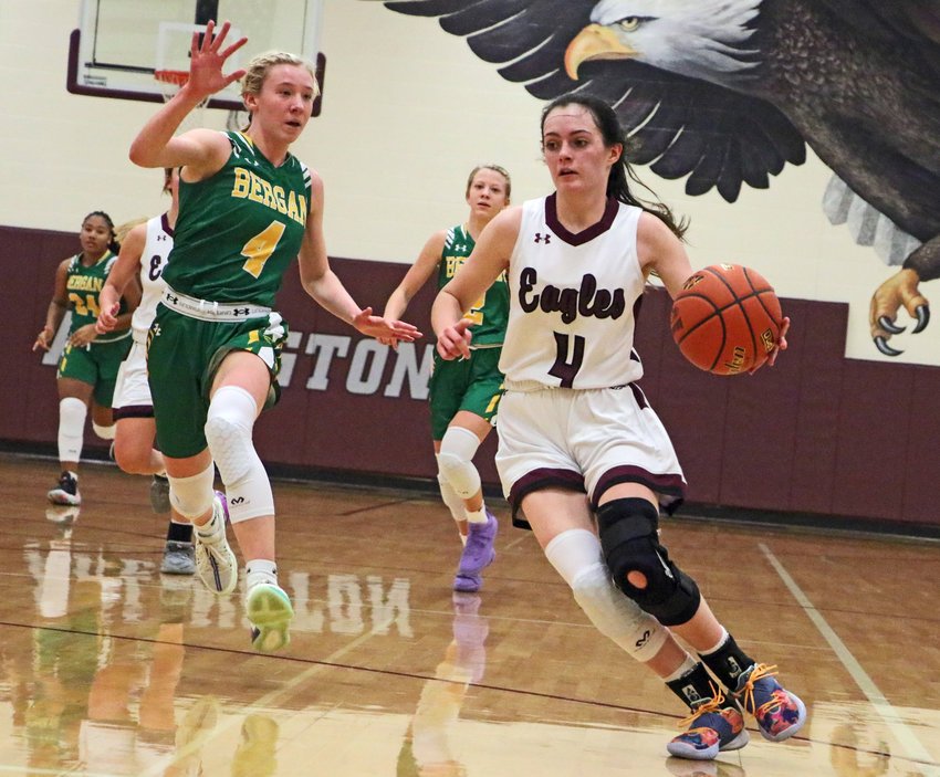 Eagles sophomore Keelianne Green, right, collects the ball off of a steal as Fremont Bergan's Kaitlyn Mlnarik and the Knights try to chase her down Saturday at Arlington High School.