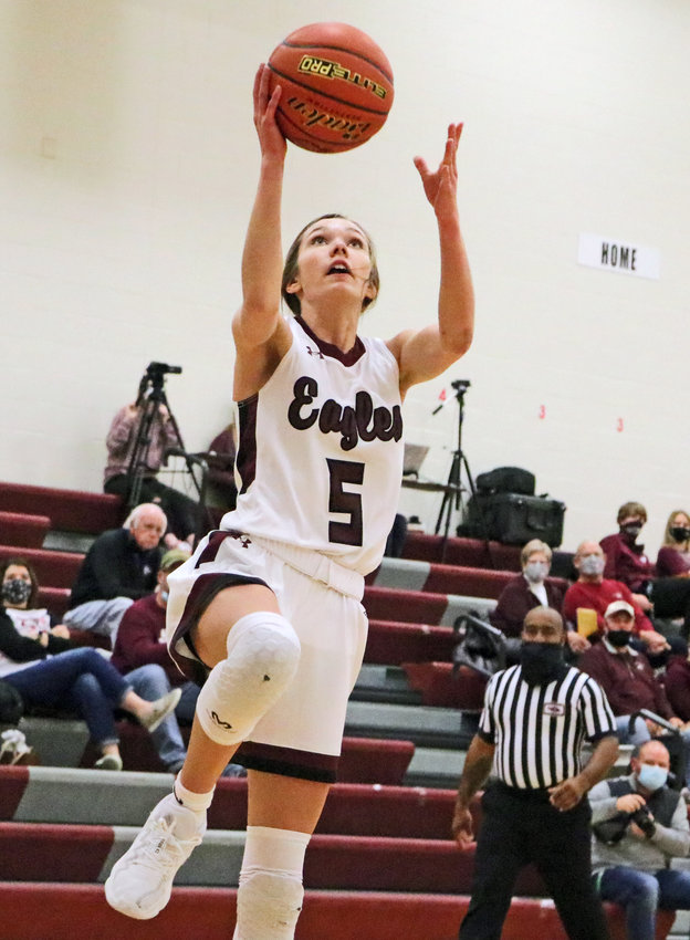 Eagles junior Kailynn Gubbels rises up for a layup Saturday at Arlington High School. The guard scored all 11 first-half AHS points.