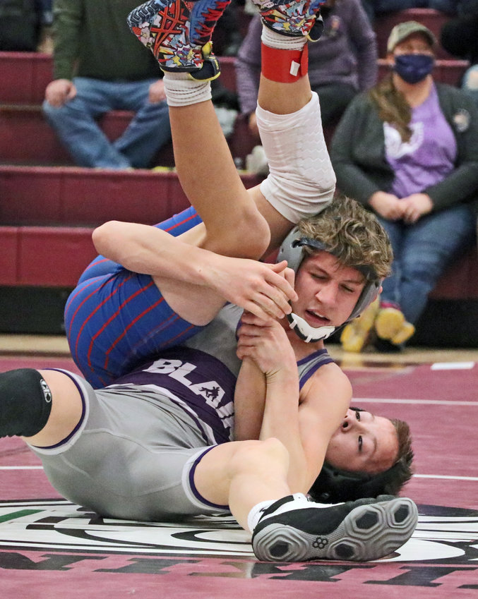 Blair 106-pounder Jesse Loges, front, latches onto Norris' Benjamin Stanley on Friday at Waverly High School.