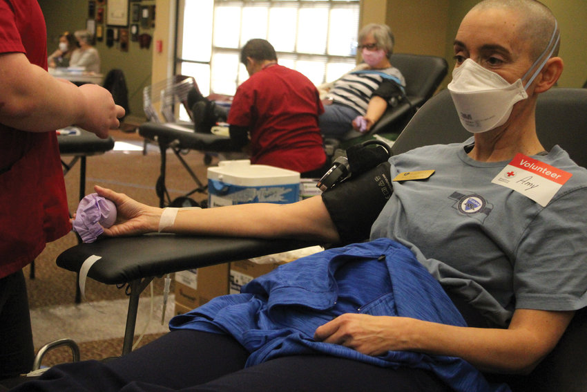 Pastor and Blair Police Department chaplain Amy Krejcarek prepares to donate blood to the Red Cross Monday at St. Francis Borgia Catholic Church for the Blue Blood Drive.
